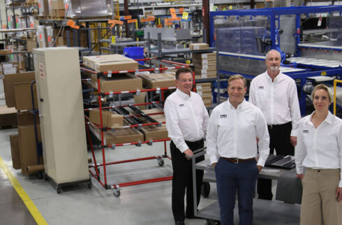 DTI coworkers in warehouse